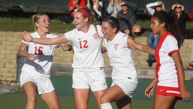 Somers' Sloane Ramsay, left, Hannon Eberts and Jenna Menta celebrate Eberts' goal during a game with North Rockland at Somers Sept. 23, 2015. Somers won 5-2 in overtime.