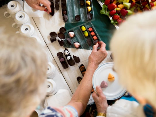 Chocolate samples are offered to the residents of the