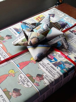 Get creative with gift wrapping this Christmas. Turn your newspaper in to a bow and wrapping paper for an eco-friendly option.