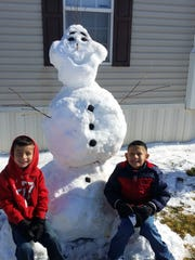 The Diaz family was able to build an Olaf snowman with some of the 15 inches of snow that fell in Carlsbad over the weekend.