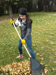 Katelyn Farrington, a Big Brothers Big Sisters volunteer, was one of 200 volunteers who raked leaves and tackled other yardwork as part of United Way's annual Day of Caring Friday. Volunteers helped 65 elderly homeowners with house projects and helped the American Red Cross install smoke detectors in another 85 homes.