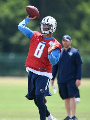 Titans quarterback Marcus Mariota (8) throws a pass during a minicamp practice St. Thomas Sports Park on June 14, 2017.