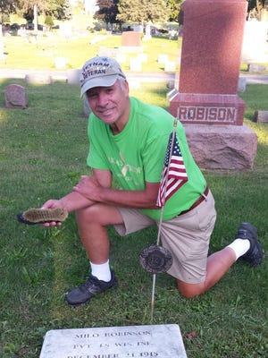 Dale Reich, a Vietnam veteran, cleaned the gravestones of 425 veterans in Oconomowoc.