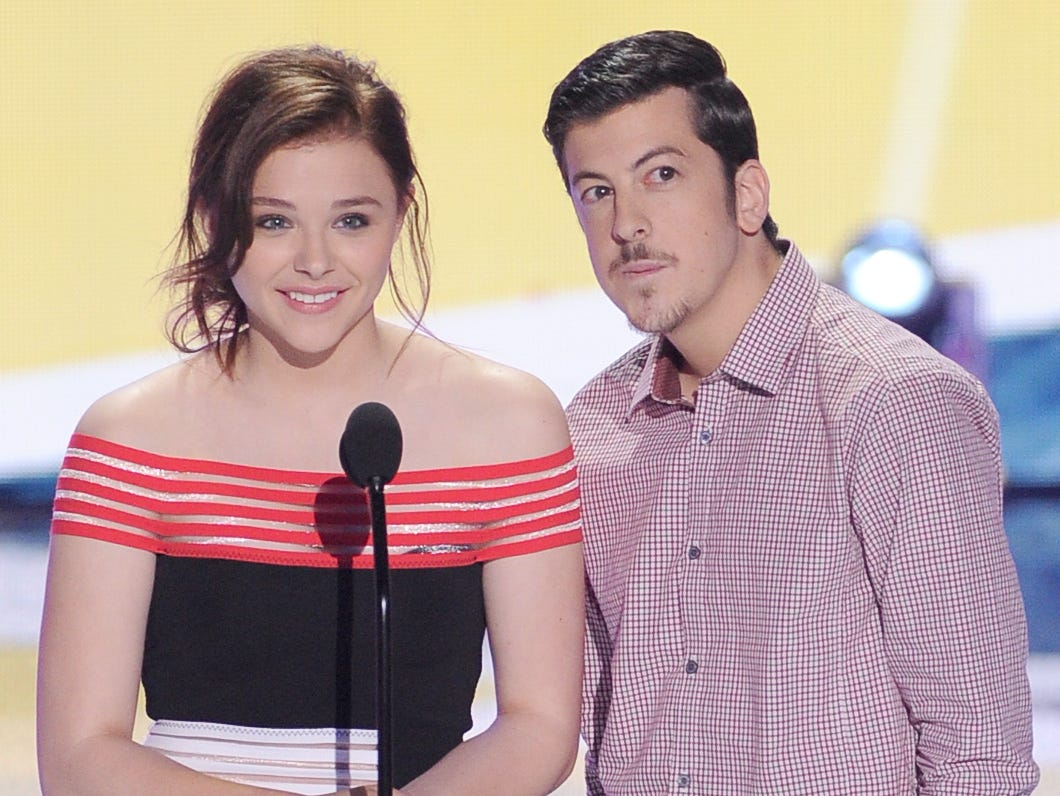 """Kick-Ass 2"" stars Chloe Grace Moretz and Christopher Mintz-Plasse take the stage."