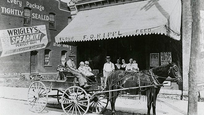 Rippl grocery store, shown here in 1914, was located at 7 Tayco St.,Menasha. Cart driver William Schmitzer is shown withMarie Rippl Kirsling and Aurea Rippl McLaughlin. Standing, from left, are Frank Rippl, Theresa Rippl, Elsie Tuchscherer, and Paula Rippl holding Cecilia Rippl Pawlowski.