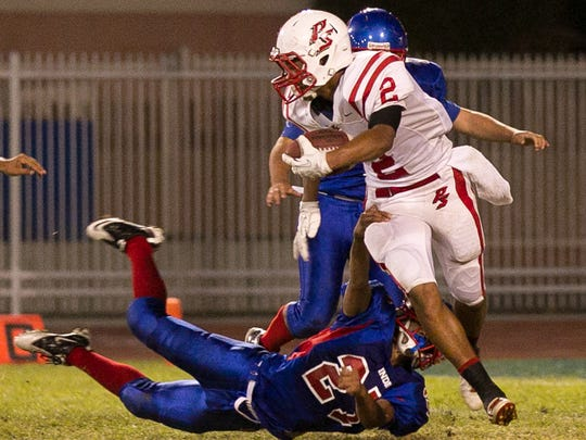 Tayler Hawkins (2) returns a punt against Indio High School as a sophomore in 2013.