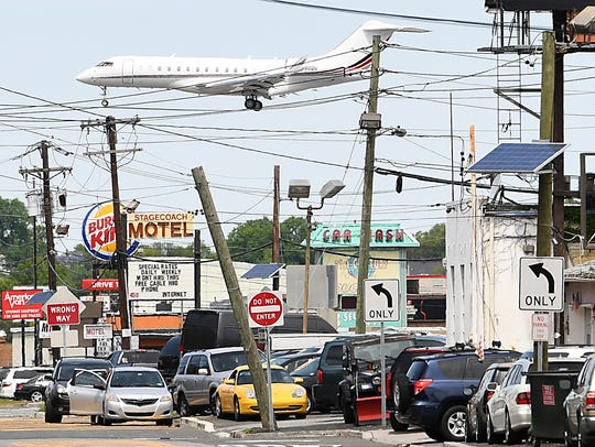 A plane flies over Rt 46 as it approaches Teterboro