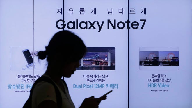 A woman walks by an advertisement of Samsung Electronics Galaxy Note 7 smartphone at the company's showroom in Seoul, South Korea, Sept. 2, 2016. Samsung Electronics recalled all of its Galaxy Note 7 smartphones on Friday after its investigation found batteries of some of the flagship gadgets caused the phone to explode or to catch fire.