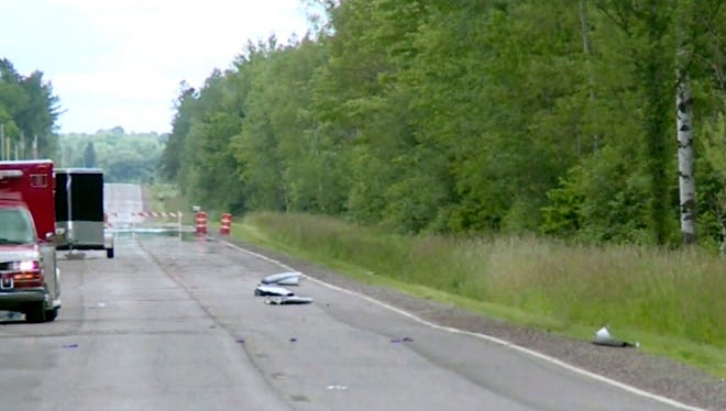 In this image made from a video provided by WAOW debris covers the road on July, 2, 2017, near Phillips, Wis., after several people were killed in an airplane crash on Saturday.