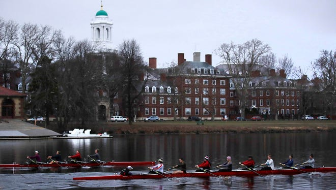 Rowers on the Charles River pass the Harvard University campus, Cambridge, Mass., March 7, 2017