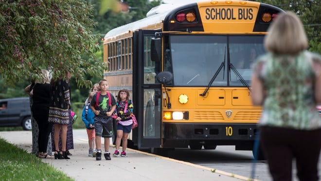 Buses drop kids off at Grissom Elementary Aug. 7 for the second day back to school following a cancellation Aug. 3 and Aug.4 due to transportation issues. While issues for many routes and schools appeared to be fixed, parent reports on social media were decidedly mixed.
