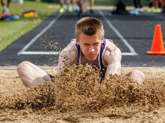 New Berlin Eisenhower freshman Tyler Zanck competes in the long jump at the Woodland Conference Championships track & field meet in Pewaukee on Tuesday, May 16, 2017.