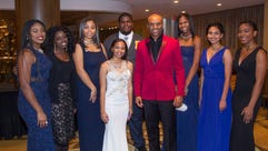 Kenny Lattimore with scholarship award winners. The