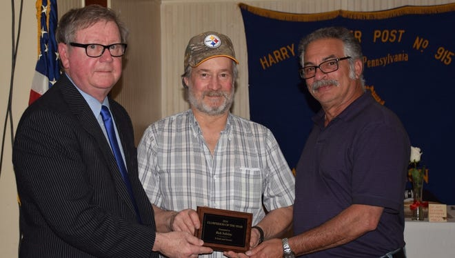 From Left:  PFFSO State Solicitor Jim Snell presents the Clubman of the Year Award to Rick Soliday of the R. Field and Stream Club with State Director Mike Carmel assisting.