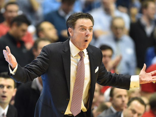 Louisville Cardinals head coach Rick Pitino reacts