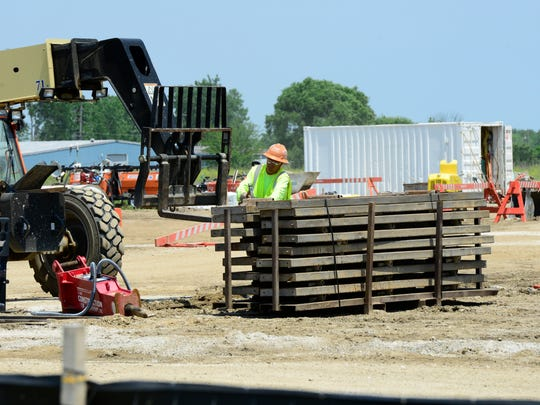 Construction of Standard Wellness LLC's medical marijuana grow facility continues in Gibsonburg's Clearview Industrial Park, despite delays from Columbus that make it unclear when the drug will be available to Ohioans.