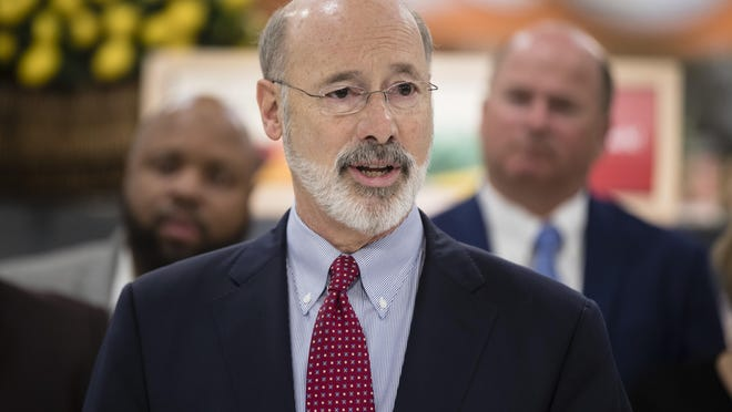 Gov. Tom Wolf speaks at a news conference at The Fresh Grocer in Philadelphia, Wednesday, Jan. 17, 2018. Democratic Gov. Tom Wolf wants to require that employers pay overtime wages to hundreds of thousands of lower-paid Pennsylvanians. (AP Photo/Matt Rourke)