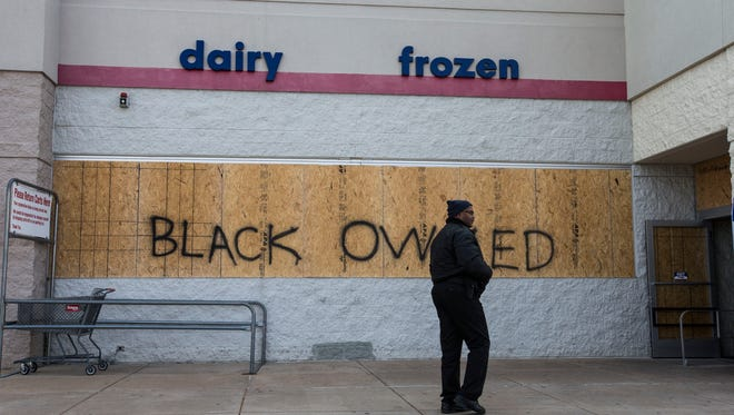 Ferguson business owners try to put their lives back together following Monday's riot.