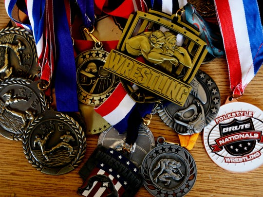 Clay Celli's wrestling medals.