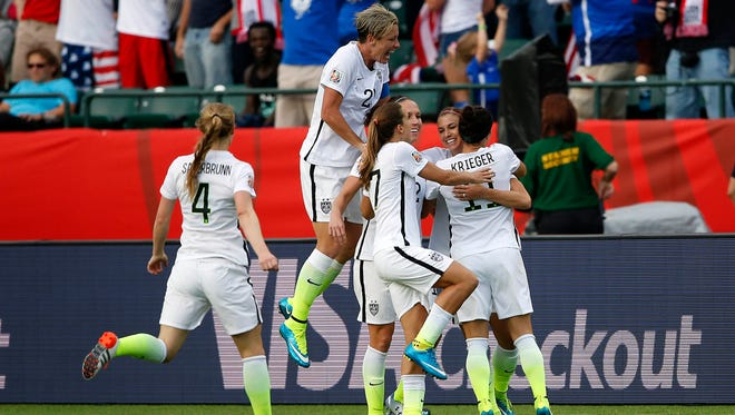 Jun 22, 2015; Edmonton, Alberta, CAN; United States forward Alex Morgan (13) celebrates scoring a goal with teammate against the Colombia during the second half in the round of sixteen in the FIFA 2015 women's World Cup soccer tournament at Commonwealth Stadium. Mandatory Credit: Michael Chow-USA TODAY Sports  ORG XMIT: USATSI-227746 ORIG FILE ID:  20150621_pjc_usa_439.JPG