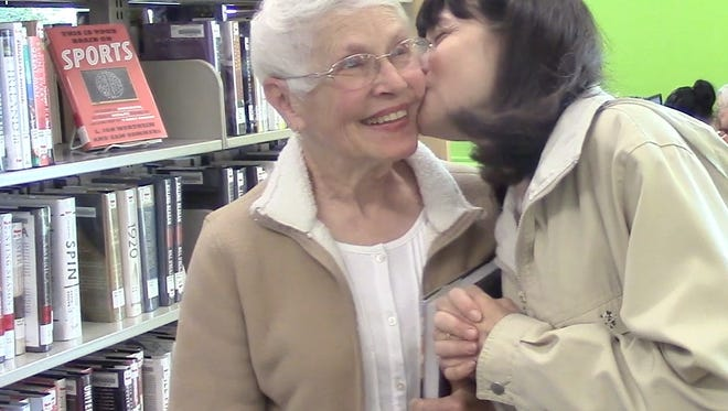 A Muncie local gives her mom a kiss for Mother's Day.