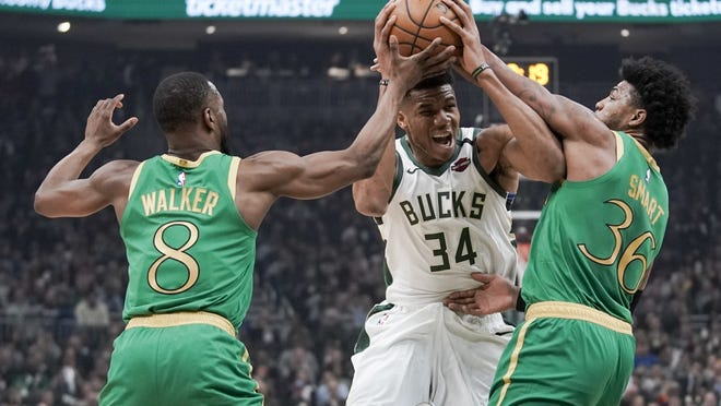 Kemba Walker (left), Marcus Smart (right) and the Boston Celtics are scheduled to resume their season against Giannis Antetokounmpo and the NBA-best Milwaukee Bucks in Florida on July 31.