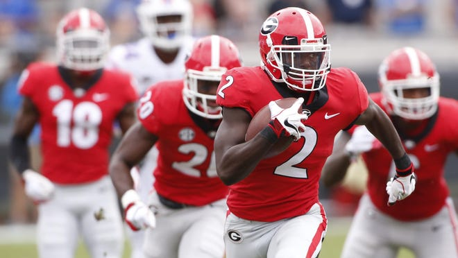 Georgia defensive back Richard LeCounte III (2) moves the ball down the field during the first half of an NCAA college football game between Georgia and Florida at in Jacksonville, Fla. Saturday, Oct. 27, 2018.