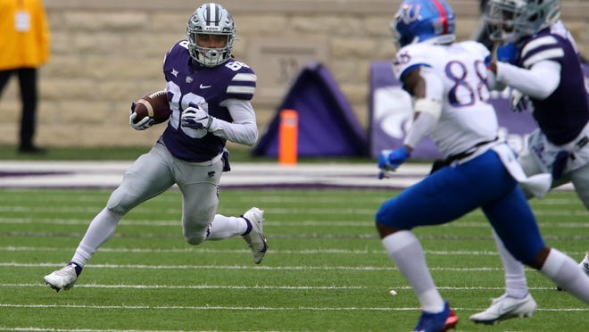 Kansas State's Phillip Brooks (88) looks for running room on a punt return Saturday against the Kansas at Bill Snyder Family Stadium. Brooks returned four punts for a school-record 189 yards and two touchdowns in he Wildcats' 55-14 victory.