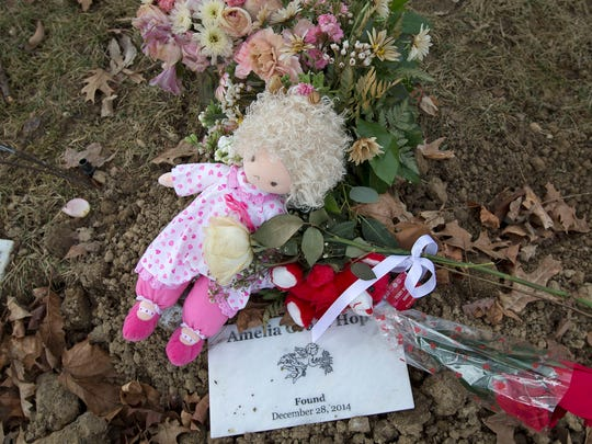 """Baby Amelia Grace Hope's fresh gravesite is seen at Washington Park East Cemetery on Jan. 21, 2015. Amelia's body was found abandoned in the woods of Eagle Creek Park on Indianapolis' Northwestside. Linda Znachko has helped bury many babies who have died tragically or have been abandoned, several buried in this cemetery. Her organization is called, """"He Knows Your Name."""""""