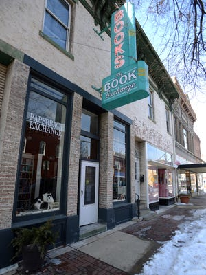 Leanne McClellan plans to move her Paperback Exchange from its current location on North Columbus Street to the corner of Main and Columbus streets. Diamond Jim's Pizza will expand to the current bookstore for additional seating.