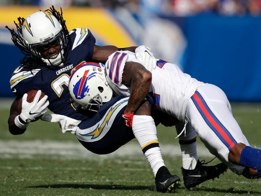 Los Angeles Chargers running back Melvin Gordon, left, is tackled by Buffalo Bills defensive back Leonard Johnson during the first half of an NFL football game Sunday, Nov. 19, 2017, in Carson, Calif. (AP Photo/Jae C. Hong)