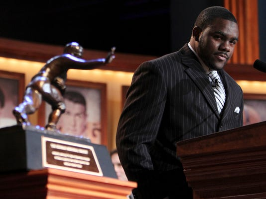FILE - In this Dec. 12, 2009, file photo, tears run down the face of Alabama running back Mark Ingram as he becomes emotional while making his acceptance speech after being named the 75th Heisman Trophy winner in New York. Ahead of the 2014 college football season, The Associated Press asked its panel of Top 25 voters, who are known for ranking the nation's top teams each week, to weigh in on which team during the Bowl Championship Series-era (1998-2013) was the best. Alabama's 2009 team was third with Ingram. (AP Photo/Kelly Kline, Pool, File)