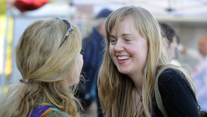 Sarah Pharis, right, smiles as she speaks with friend Bhakti Foster during the We HEART Sarah benefit concert held at the Frontier Culture Museum in 2010. Featuring several local bands, proceeds from the event assist Pharis, who was fighting a rare form of cancer known as ocular melanoma.