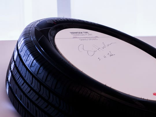 Governor Bill Haslam signs a tire at Hankook's grand