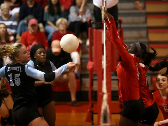 Leon's Shania Cromartie leaps up to block Hagerty's