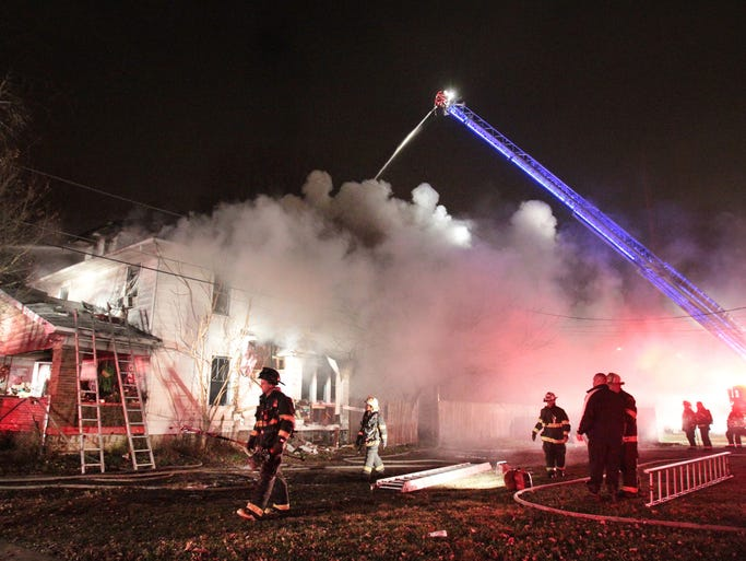 Indianapolis Fire Department firefighters battle a blaze at 444 Trowbridge St. that gutted the home of Dennis and Linda Godbold, 56, on Tuesday, Dec. 3, 2013. The Goldbolds, who lived there 20 years, had let their insurance lapse. Also living in the home with them was his sister, her son, and two foster children.