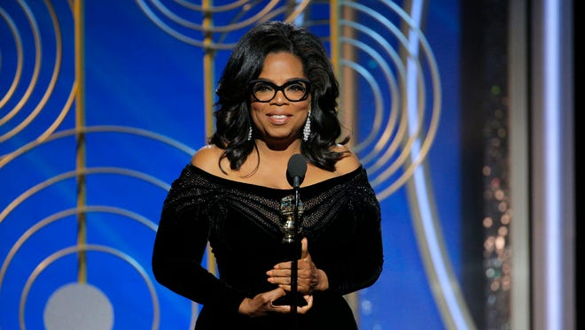 Oprah Winfrey accepts the Cecil B. DeMille Award at the Golden Globe Awards on Sunday in Beverly Hills, Calif.