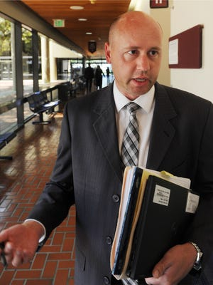 Prosecutor and Senior Deputy District Attorney Tom Dunlevy speaks to reporters after the Heather Locklear case was continued at the Ventura Courthouse.