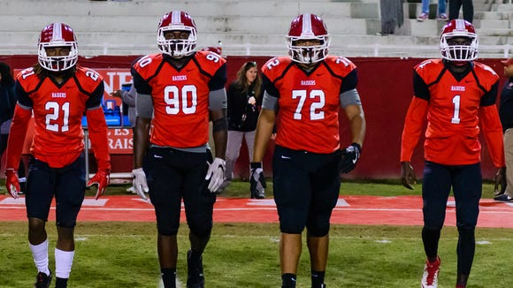 From left, Greenville seniors Prince Glenn (21), Tre'Dorian Arnold (90), Cameron Thomason (72) and Ty Hellams (1) take the field as captains before the Red Raiders' playoff game against York Nov. 10.