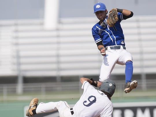 Maclay's JD Gladden slides safely into second base under Jake Crandon of Canterbury School during a FHSAA Class 3A semifinal game on Friday at Jet Blue Park. Canterbury won 2-1 in extra innings.