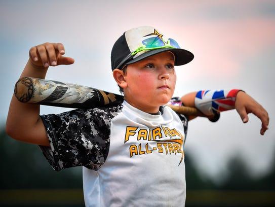 Fairview 12U Baseball All Stars Kylan Keller listens