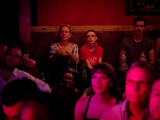 "Jessi ""Zazu"" Wariner, center, watches performers during"