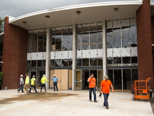 Construction workers continue work at John Overton