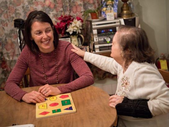 Volunteer Jenny Gustafson chats with Ruby Truette,
