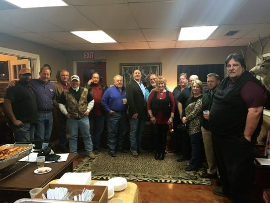 Members of the San Angelo Regional Manufacturers Alliance meet at West Texas Industrial Engines for a social gathering in January.