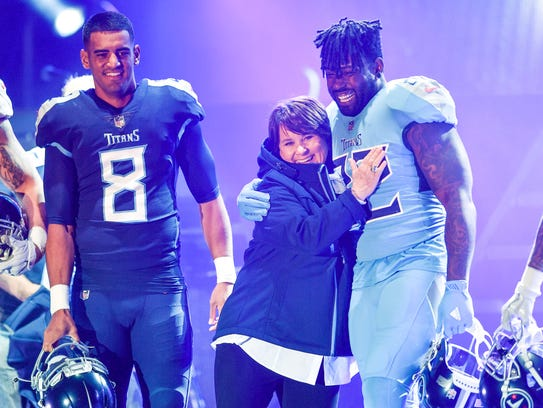 Titans owner Amy Adams Strunk hugs Tennessee Titans