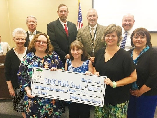 Foundation board members presented the grant to the