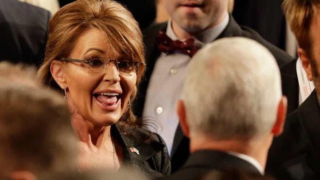 Sarah Palin greats Republican vice-presidential nominee Gov. Mike Pence following the the third presidential debate between Democratic presidential nominee and Hillary Clinton Republican presidential nominee Donald Trump at UNLV in Las Vegas, Wednesday, Oct. 19, 2016.