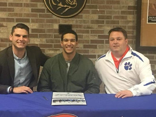 Garden City senior Eian Castonguay (center) is all smiles after signing with Air Force Academy. He is flanked by Garden City athletic director Garrett Simpson (left) and football coach Jim Baker.