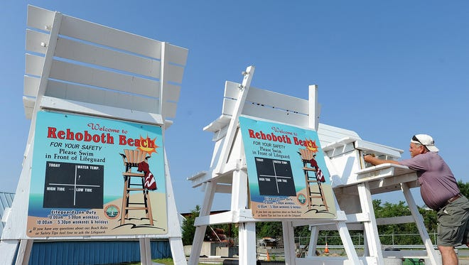 A city of Rehoboth Beach employee works to repair lifeguard stands that were vandalized in 2012. On July 9, seven stands were stolen, officials said.
